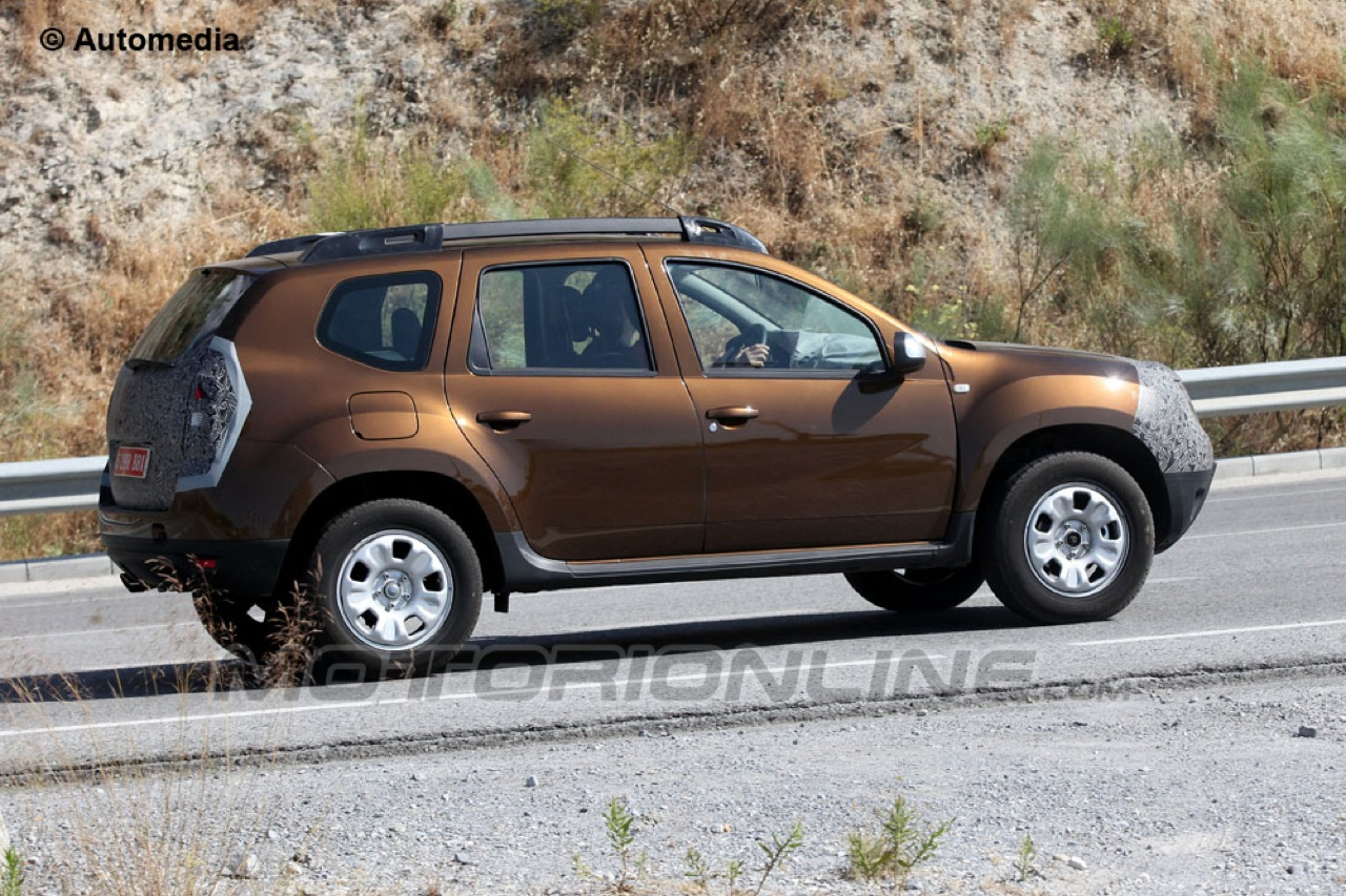 Dacia duster facelift foto spia 20 07 2013 1 5 for Immagini dacia duster