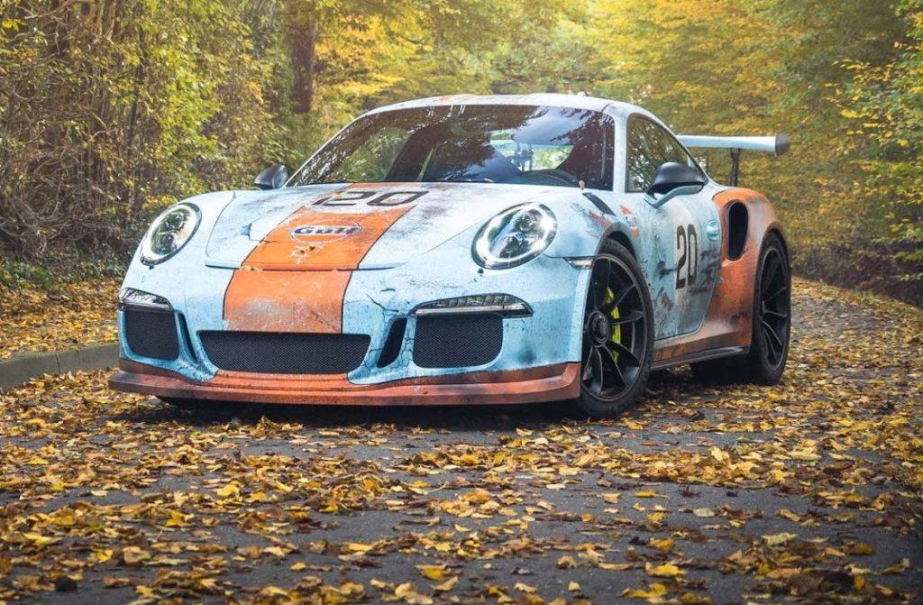 Porsche 911 GT3 RS, fascino a favore di obiettivo con l'effetto ruggine [FOTO]